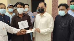 Lawmakers, officials distribute compensation cheques among villagers